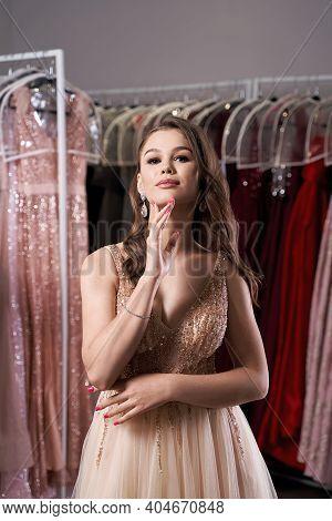 Young Beautiful Brunette Girl Wearing A Full-length Beige Yellow Champaign Chiffon Slit Prom Ball Go