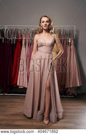 Young Beautiful Blonde Girl Wearing A Full-length Pale Pink Glitter Chiffon Draped Prom Ball Gown. M