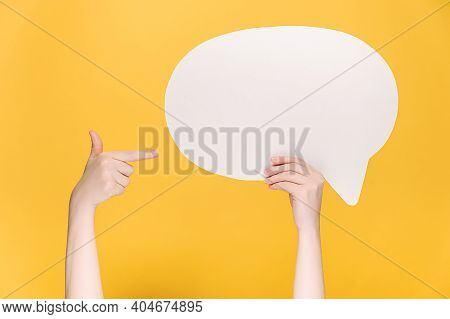 Close Up Of Unrecognizable Young Female Holding And Pointing At Blank White Paper Speech Bubble, Iso