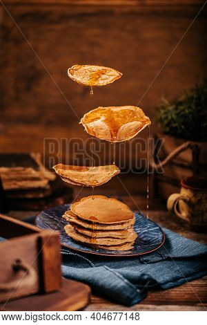 Delicious Flying American Pancakes With Flowing Mapple Syrup