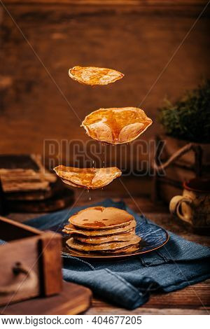 Flying American Delicious Pancakes With Flowing Mapple Syrup
