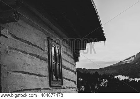 Log Cabin House In Vlkolinec, Traditional Settlement Village In The Mountains.black And White Photog