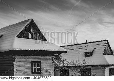 Log Cabin Houses In Vlkolinec, Traditional Settlement Village In The Mountains.black And White Image
