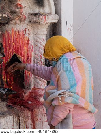 Unrecognised Asian Nepalese Woman Lighting A Candle And Praying. Hinduism Religion Prayers Nepal Asi