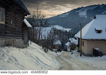 Log Cabin Houses In Vlkolinec, Traditional Settlement Village In The Mountains.