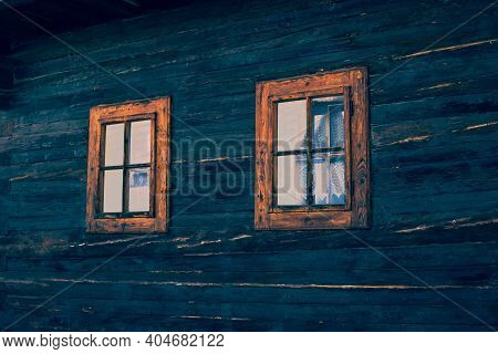 Close Up Shot Of Old Wooden Hut Window.vlkolinec, Traditional Settlement Village In The Mountains.