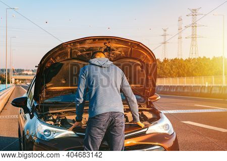 Man With His Broken Car On The Highway Roadside. Automobile Breaks Down On The Autobahn. Open The Ca