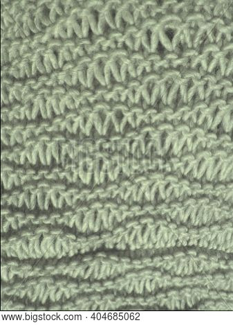 Knitted Pattern Of Gray Yarn. Lush Machine Or Hand Knitting. Warm Wardrobe For The Autumn-winter Per