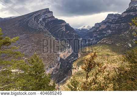 The Anisclo Canyon Seen From Above In Autumn, The Erosion Of The Bellos River In The Mountains, In T