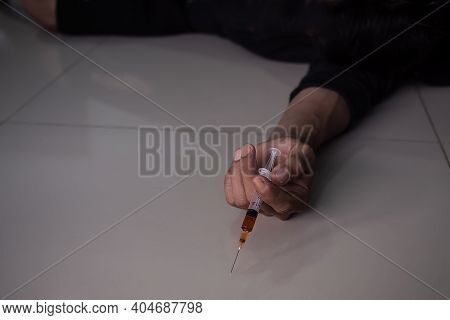 Hand Holding Heroin In Injecting. Narcotic Recreational Drugs, Habit-forming Substance Concept.