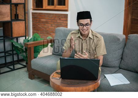 Man In Civilian Uniforms Use Laptop, Smartphone And Paperwork