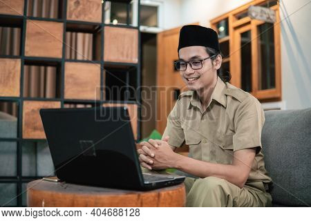 Man In Civilian Uniform Looking Screen Monitor While Use Laptop