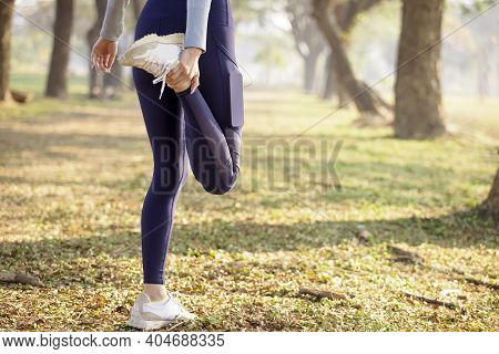 Rear View Young Woman  Warm Up For  Workout Before Running In The Park