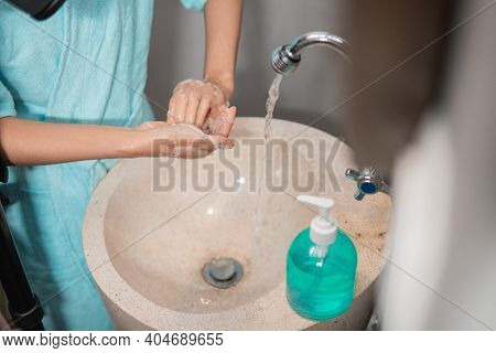 Girls Hands Wash Their Hands And Fingers With Liquid Soap Until Foamy