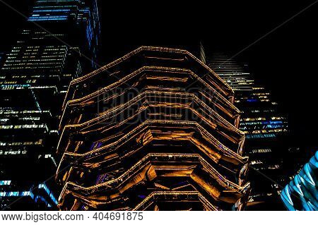 The Vessel And Two Tall Buildings Illuminated At Night At The Hudson Yards In Midtown Manhattan. 1/2
