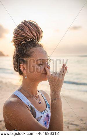 Yogi Woman Practicing Anuloma Viloma Pranayama, Alternate Nostril Breathing. Control Prana, Control