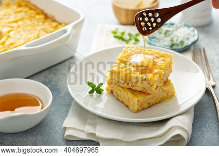 Slices Of Cheesy Cornbread Freshly Baked Served With Butter And Honey, Southern Food