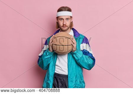 Serious Blue Eyed Male Basketball Player With Stubble Long Hair Holds Ball Ready For Playing Game We
