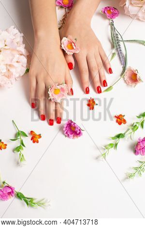 Well-groomed Womens Hands With Red Manicure Against The Background Of Bright Colors Photo For The Ma