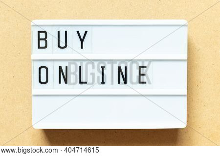 Lightbox With Word Buy Online On Wood Background
