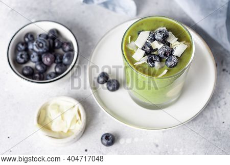Chia Pudding With Green Superfood Powder, Banana, Almond Milk Topped With Blueberries And Coconut Ch