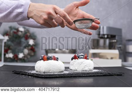 Process Of Making Berry Cakes. Cakes Anna Pavlova And Hands Of Confectioner.
