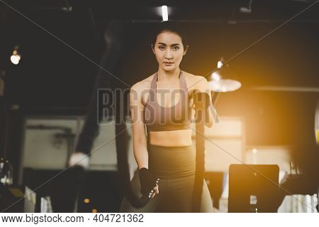 Young Asian Woman Working Out With Battle Ropes At Fitness Center She Get Determined Sport Girl Get