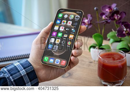 Alanya, Turkey - January 7, 2020: Man Hand Holding Iphone 12 Pro Max Gold With Home Screen Ios 14 On