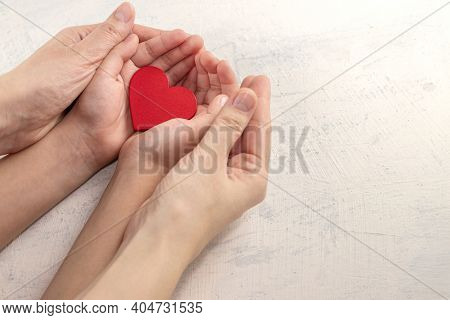 Hands Holding Red Heart. Health Care, Love, Organ Donation, Mindfulness, Wellbeing, Family Insurance