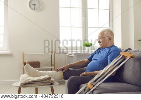 Mature Man With Broken Leg In Cast Stays At Home And Waits For His Bone Fracture To Heal