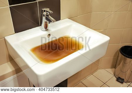 Clogged Sink With Dirty Water In A Cafe Toilet. Blockage Problems In The Bathroom And Toilet