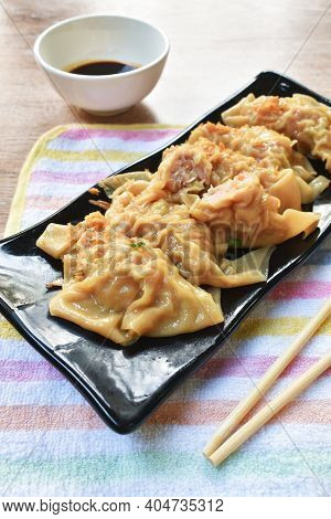 Boiled Dumpling Or Gyoza Stuffed Mashed Pork And Shrimp With Vegetable Topping Fried Chop Garlic On