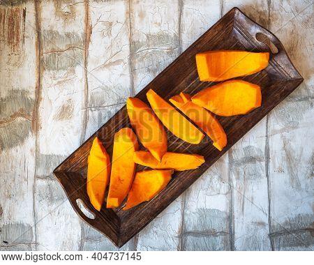 Sliced Pumpkin On An Oblong Wooden Tray Top View