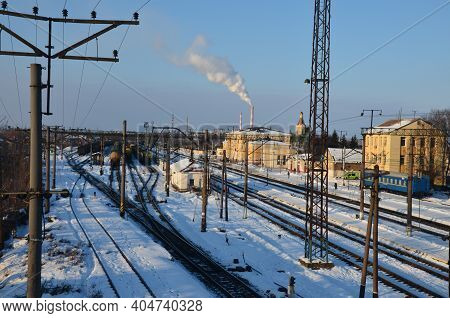Railway Track And Train Station Covered By Snow While It Is Snowing On The Heavy Snow Day