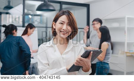 Portrait Of Successful Executive Businesswoman Smart Casual Wear Looking At Camera And Smile With Di