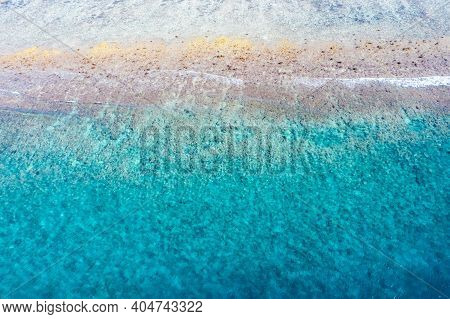 Surfing Aerial, Beach On Aerial Drone Top View With Ocean Waves Reaching Shore With Coral Reef And S