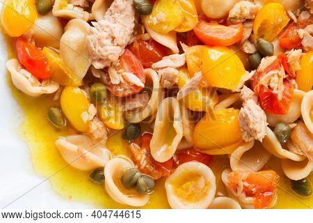 Close Up Of Tuna Orecchiette Pasta And Cherry Tomatoes Food Background