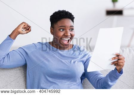 Portrait Of Excited African American Woman Holding And Reading Paper Letter, Receiving Good News, Sc