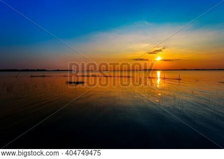 Sunset River Sky Clouds Landscape. River Sunset Horizon View. Sunset River Landscape. River Sunset V
