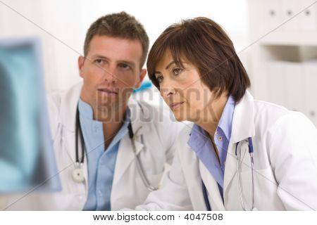 Doctors Looking At X-Ray Image