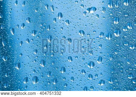 Raindrops On The Glass In Rainy Weather.the Glittering, Shiny Surface Of Water On Glass.water Drops