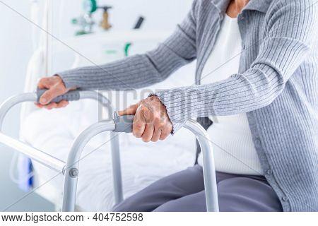Close-up Senior Woman Using A Walker At Hospital.