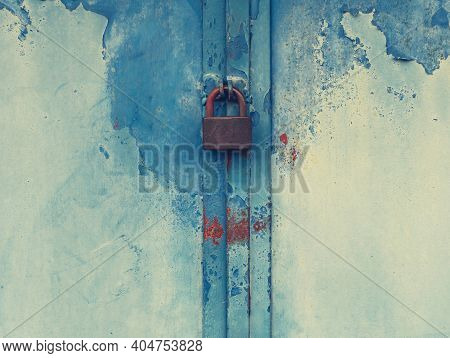 Detail Of Grunge Old Door With Obsolete Yellow Green Paint. Rusty Marks And Stains Of Rust On Obsole