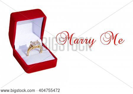 Wedding Ring. Wedding Ring with a Red Box. Engagement Ring in a Red Velvet Ring Box. Isolated on white. Room for text.