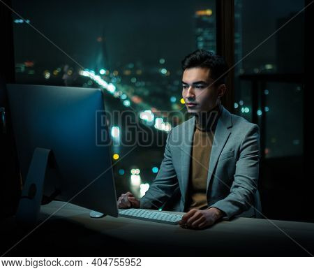 Man Write Emails at Work With Beautiful Night View