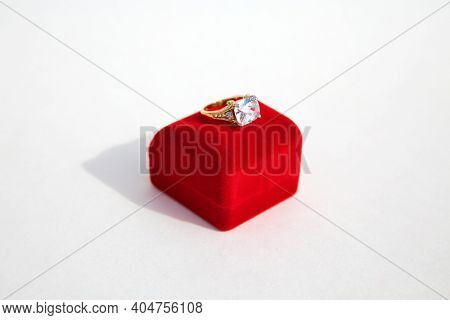 Wedding Ring.  Wedding Ring with a Red Velvet Box. Engagement Ring in a Red Ring Box. Isolated on white. Room for text.