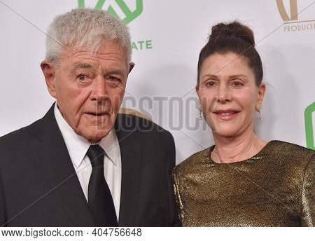 LOS ANGELES - JAN 19:  Producers Richard Donner and Lauren Shuler Donner arrives for the 30th Annual Producers Guild Awards on January 19, 2019 in Beverly Hills, CA
