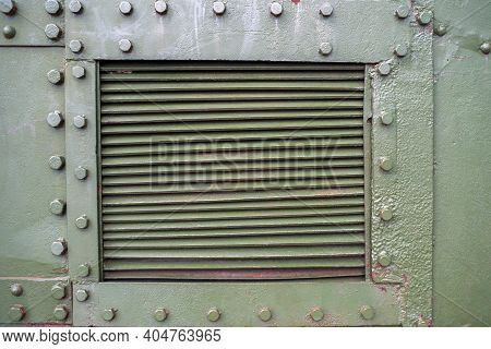 Abstract Green Metal Background With Bolts And Rivets, Copy Space. Old Painted Steel Texture, Detail
