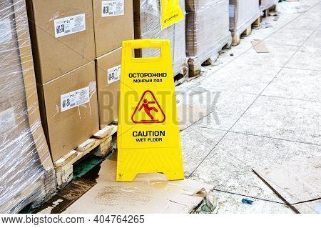 Samara, Russia - January 2, 202: Warning Sign Wet Floor At The Svetofor Retail Discounter