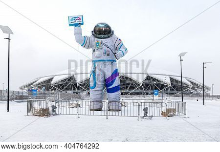 Samara, Russia - January 2, 202: The Figure Of An Astronaut Near The Samara Arena Football Stadium